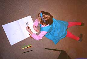 a little girl creating a book at a workshop with Phoebe Stone
